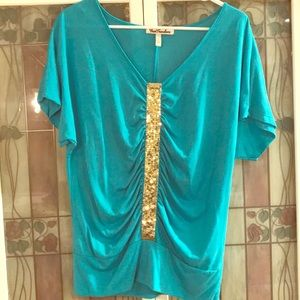 Teal green top with gold sequins.